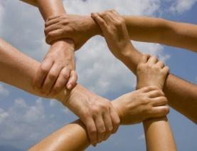 group-holding-hands-pentagon-shape